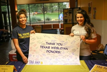 Students with thank you poster